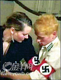 The adjoining happy snap appeared in newspapers overseas (this was in China) of him with a young lady dressed as Hitler has not received the public attention that some feel it deserves.